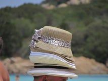 Säljare av hattar i Costa Smeralda Fotografering för Bildbyråer