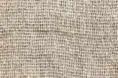 Sällan vävt grått grovt tyg sackcloth royaltyfria foton