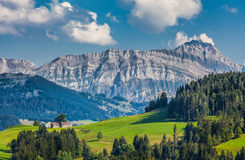 Säntis summit, Appenzellerland, Switzerland. Idyllic landscape in the Alps with green meadows and famous Saentis mountain top in the background, Appenzellerland Royalty Free Stock Photo