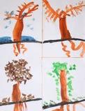 Säsongerna (barns teckning) royaltyfria bilder