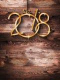 2018 säsongsbetonade bakgrund för lyckligt nytt år med verklig trägräsplan sörjer Arkivbilder