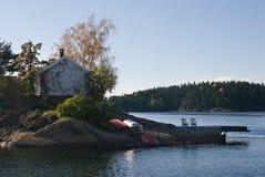 Säsongsbetonat norskt hus Arkivbild