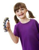 Sätta en klocka på leka musik för liten flicka med klirr arkivfoton