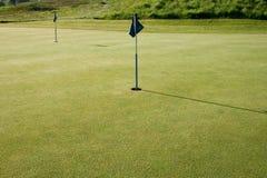 sätta för golfgreen Arkivfoto