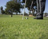 Sätta och golfare Arkivfoton