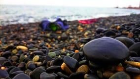 sätta på land pebblen Arkivbild