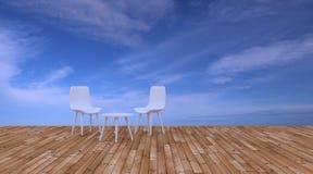 Sätta på land vardagsrummet och balkonger med stol och seascape i sommarhavet Arkivfoto
