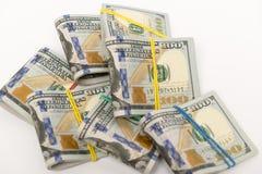 Sätze von hundert Dollarscheinen Stockfotos
