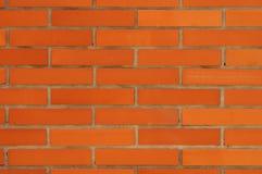 Säubern Sie orange Backsteinmauer-Muster Stockfoto