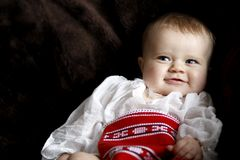 Säuglingsschätzchenlächeln Lizenzfreie Stockfotos