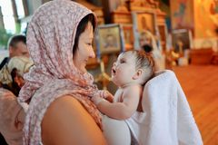 Säuglingstaufe Stockfoto