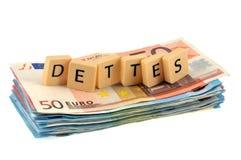Słowo dług pisać w Francuskim i umieszczający na zwitku banknoty royalty ilustracja