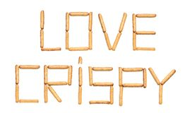 Słowo miłości Crispy opanowany chlebowymi kijami z makowymi ziarnami na białym tle obrazy stock