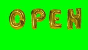 Słowo otwarty od helowych złoto balonu listów unosi się na zieleń ekranie - zbiory