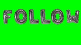 Słowo podąża od helu srebra balonu listów unosi się na zieleń ekranie - zdjęcie wideo