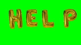 Słowo pomoc od helowych złoto balonu listów unosi się na zieleń ekranie - zbiory wideo