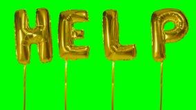 Słowo pomoc od helowych złotych balonowych listów unosi się na zieleń ekranie - zbiory