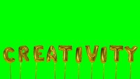 Słowo twórczość od helowych złotych balonowych listów unosi się na zieleń ekranie - zbiory wideo