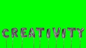 Słowo twórczość od helu srebra balonu listów unosi się na zieleń ekranie - zbiory