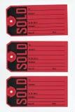 såld etikett arkivbild