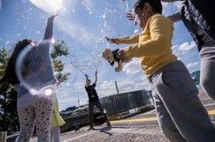 Såpbubblor på pir i Zurich Arkivbild