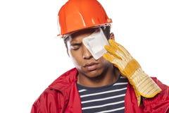 sårad arbetare för konstruktion royaltyfri fotografi