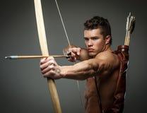 Sårad gladiator med pilbågen royaltyfri fotografi