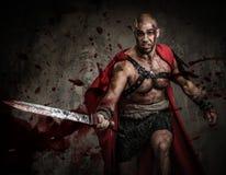 Sårad gladiator med svärdet arkivfoton