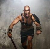 Sårad gladiator med svärdet fotografering för bildbyråer