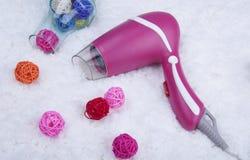 Sèche-cheveux rose Images libres de droits