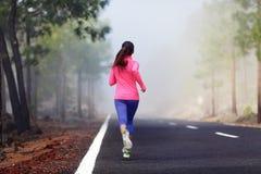 Séance d'entraînement courante saine de femme de coureur Image libre de droits