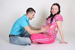 Séance d'homme et de femme enceinte Photo libre de droits