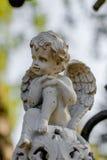 Séance et rêver d'ange Photos stock