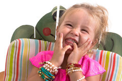 Séance et rire d'enfant image libre de droits