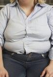 Séance obèse de femme Photo stock