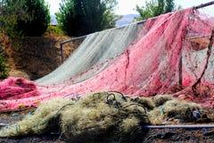 Séchage coloré de filets de pêche Photographie stock libre de droits