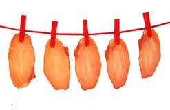 Séchage de viande sec par jambon sur la corde à linge Photo stock