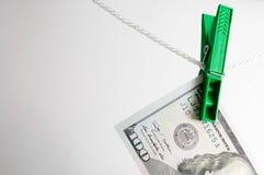 Séchage du dollar sur la corde à linge Photographie stock libre de droits