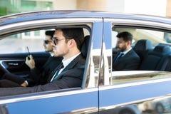 Sécurité Team And Businessman In Car photographie stock libre de droits