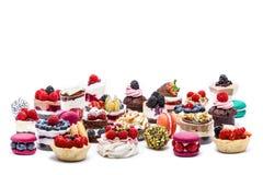 Sélection des gâteaux, des macrons, des petits gâteaux et des festins de miniature Image stock