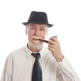 Sénior com chapéu e tubulação Imagem de Stock