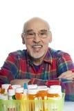 Sénior com frascos da prescrição imagens de stock