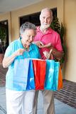 Séniores da compra - inflação Fotos de Stock Royalty Free