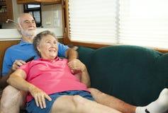 Séniores do rv que relaxam no sofá Foto de Stock Royalty Free