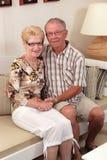 Séniores felizes em casa Imagens de Stock Royalty Free