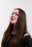 Série da emoção de menina ucraniana nova e bonita - tongue a lambedura dos bordos fotos de stock