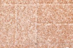 Série da textura - cristais da neve no bloco vermelho 3 do pátio Imagem de Stock Royalty Free