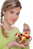 Série saine de style de vie - femme avec la salade de fruits Photos stock