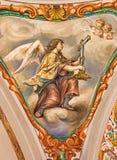 Séville - le fresque baroque de l'ange avec la croix symbolique dans l'église Hospital de los Venerables Sacerdotes Photos stock