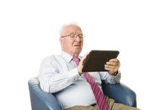 Sênior com tabuleta Foto de Stock Royalty Free